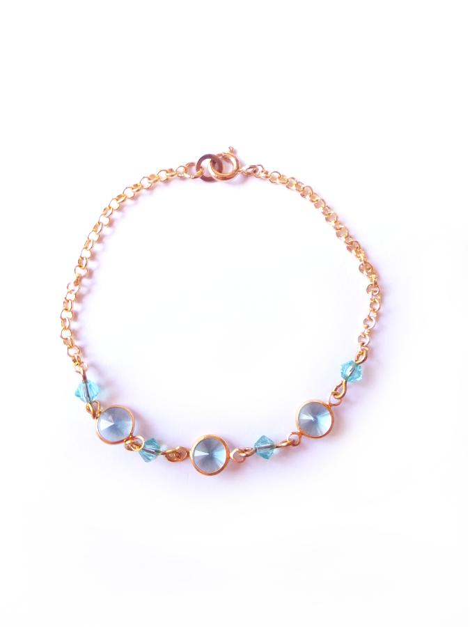 Bracelet doré cristal perles rondes et toupies Swarovski